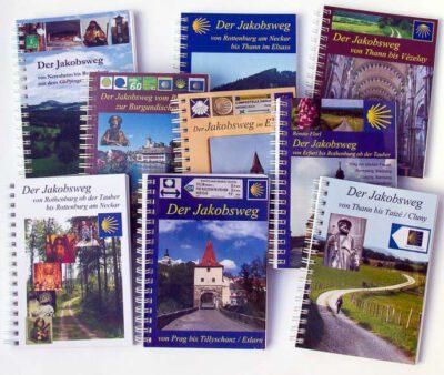 Bild von vielen Pilgerführern für Jakobswege in Deutschland, Schweiz und Frankreich.